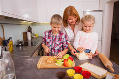 Mother and her children preparing food Stock Photography