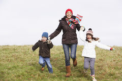 Mother And Her Children Running In The Park Stock Image