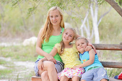 Mother and her children Stock Images