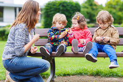 Mother and her children in summer park Stock Photography