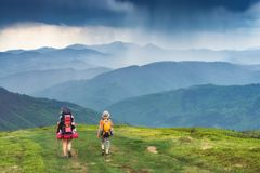 Mother with her children on a trekking in a mountains Stock Photography