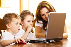 Mother with her children using laptop Royalty Free Stock Photography