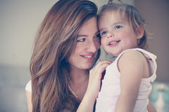 Mother and her cute baby at home. Mother holding little baby in. Mother and her cute baby at home. Mother enjoying in free time with her little baby. Mother Stock Photo