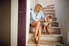 Mother and daughter sitting on the stairs royalty free stock image