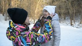 Mother and her cute daughter. In the winter forest stock footage