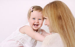 Mother and her cute little baby girl having fun at home Royalty Free Stock Photos