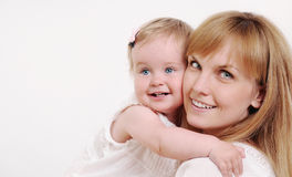 Mother and her cute little baby girl having fun at home Stock Images