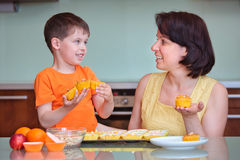 Mother and her cute little boy baking muffins Royalty Free Stock Image