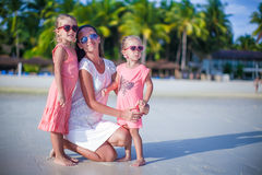 Mother and her cute little girls relaxing on Stock Photography