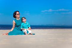 Mother and her cute little son at tropical beach Stock Images