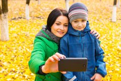 Mother and her cute young son taking a selfie Stock Images