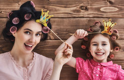 Mother and her daughter with accessories Stock Photos