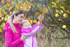 Mother and her daughter in autumnal Stock Photos