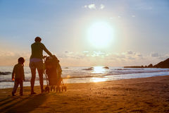 Mother with her daughter and baby on a sandy beach Stock Images