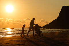 Mother with her daughter and baby on a sandy beach Stock Image