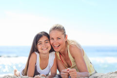 Mother with her daughter at the beach Royalty Free Stock Photography