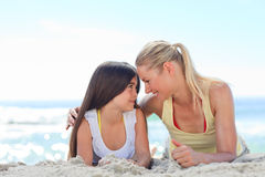 Mother with her daughter at the beach Stock Photo