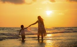 Mother with her daughter on the beach Stock Images