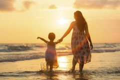 Mother with her daughter. On the beach Stock Image