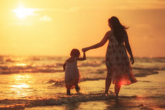 Mother with her daughter on the beach Stock Image