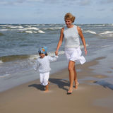 Mother with her daughter on the beach Royalty Free Stock Image