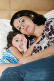 Mother and her daughter on the bed Royalty Free Stock Photo