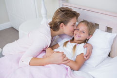 Mother with her daughter at bedtime Royalty Free Stock Images