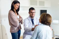 Mother with her daughter being examined with stethoscope by pediatrician. Royalty Free Stock Photo