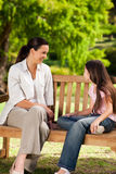 Mother and her daughter on the bench Royalty Free Stock Photography