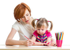 Mother and her daughter child girl pencil together Royalty Free Stock Photo
