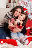 Mother with her daughter at Christmas Royalty Free Stock Photo