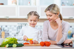 Mother  and her daughter cooking in the kitchen Stock Photography