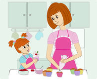 Mother and her daughter cooking in the kitchen Royalty Free Stock Photography