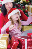 Mother and her daughter with cristmas presents Stock Photography