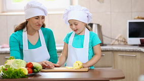 Mother with her daughter cut pepper stock footage