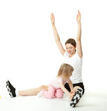 Mother and her daughter doing sport exercises Royalty Free Stock Image