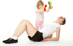 Mother and her daughter doing sport exercises Stock Images