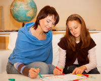 Mother and her daughter drawing. Royalty Free Stock Photos