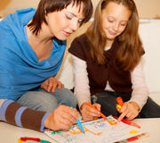 Mother and her daughter drawing. Stock Photo