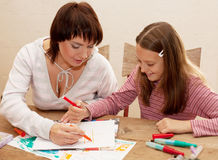 Mother and her daughter drawing. Stock Image