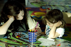 Mother and her daughter drawing together Royalty Free Stock Photography