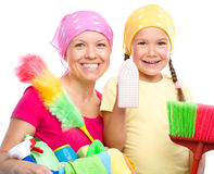 Mother and her daughter are dressed for cleaning Royalty Free Stock Photography