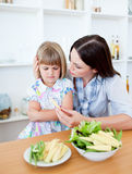Mother and her daughter eating Royalty Free Stock Photos
