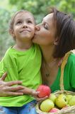 Mother and her daughter eating Royalty Free Stock Image