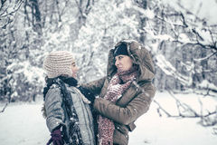 Mother and her daughter enjoying winter day outdoors. Retro look Royalty Free Stock Image