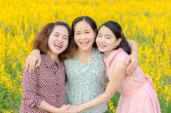 Mother and her daughter at flower field. Asian mother and her daughter at flower field Royalty Free Stock Photos