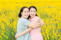 Mother and her daughter at flower field Royalty Free Stock Photos