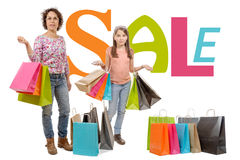 Mother is her daughter go shopping during sales Stock Images