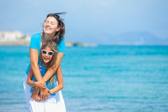 Mother and her daughter having fun on beach Royalty Free Stock Photo