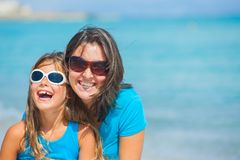 Mother and her daughter having fun on beach Stock Image